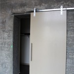 Some units have exposed concrete wall and cool sliding closet doors