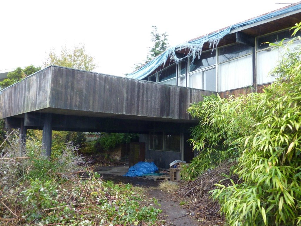 12730 9th Ave NW Before Exterior Hoarder Mid Century Modern Transformed