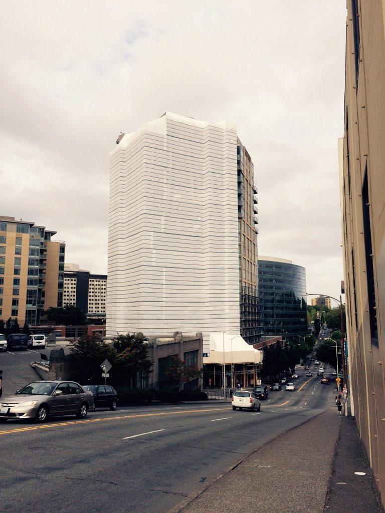 The side of the 18-story at 2200 Westlake is covered up for the last phase of years-long repair project.